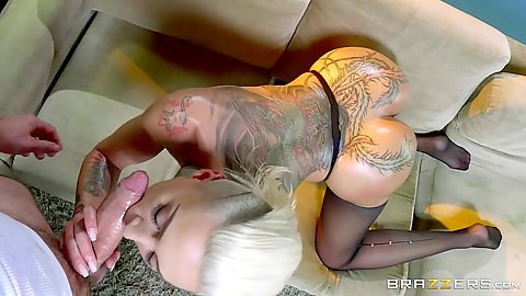 Oiled up inked girl Bella Bellz with ripped nylons gives oral