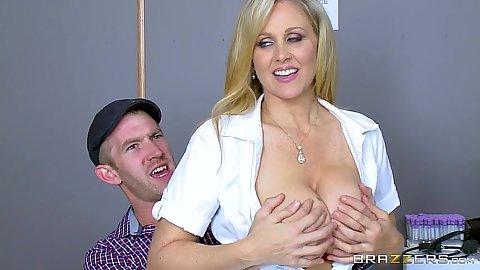Big tits blonde milf doctor Julia Ann blowing a very big dick