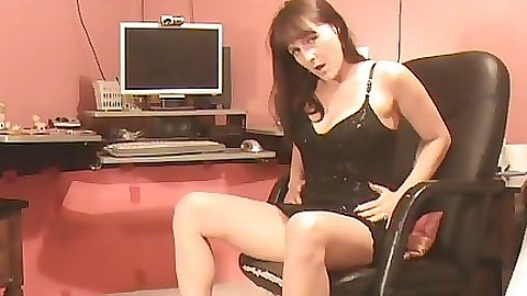 Milf sits in the office and decides to film herself