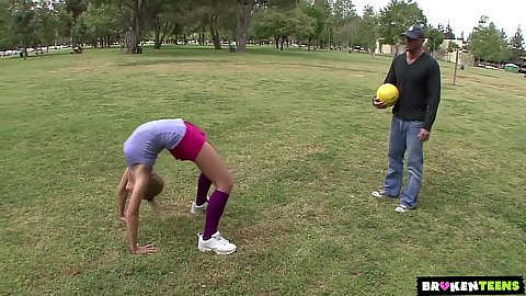 Public flexible teen Ally Kay showing her moves while playing sports