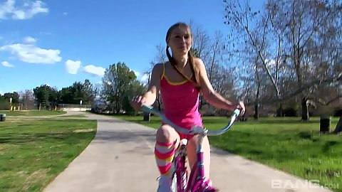 Biking around the park with young spinner Tiffany Flowers