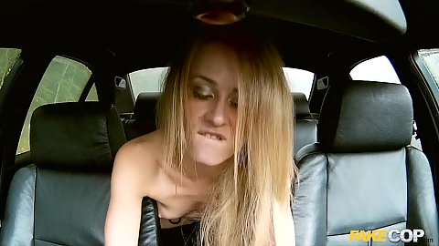 Playful woman fucks cop in the back seat of police car