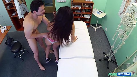 Alexis bends over hospital exam bed and doctor enters from behind