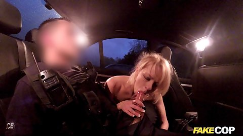 Police officer getting head from blonde in his car