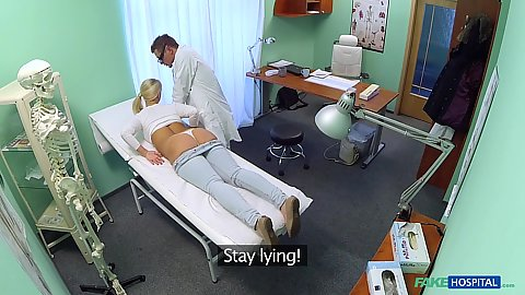 Pulled down pants blond getting her ass examined by doctor