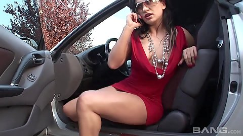 Inviting brunette Lea talking on a phone getting out of car
