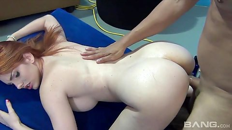 Naughty redhead with large chest Lilith Lust spanked and fucked from the back