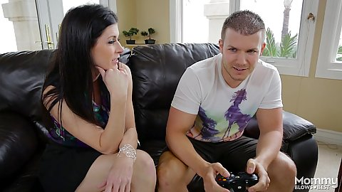 Brunette milf India Summer sexy and aroused for video game playing male