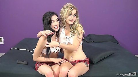 Brunette and blonde petite teen Jaelyn Chase and Aiden Ashley hugging each other
