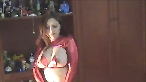 Sexy milf with big tits in a tight red mini skirt