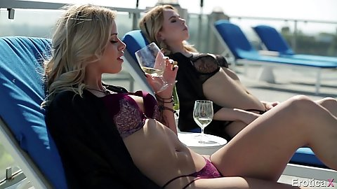 Alina West and Jessa Rhodes relaxing under the sun having some wine