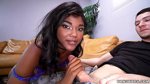 Cute black teen Yara Skye holding a dick in her hand and sucking it