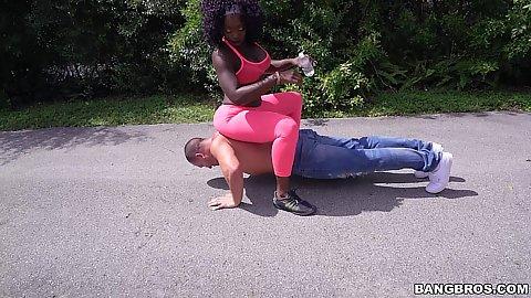 Big ass ebony milf Vickie Starxxx sits on guy doing pushups on street