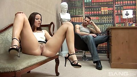 Claudia Rossi sits on chair with opens legs and no panties