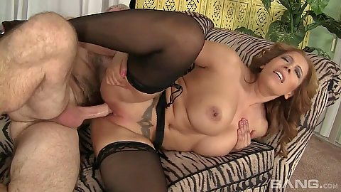 Filthy big chested milf Nicky Ferrari having sex sideways on sofa