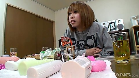 Asian girl Ri Ri cheks out sex toys
