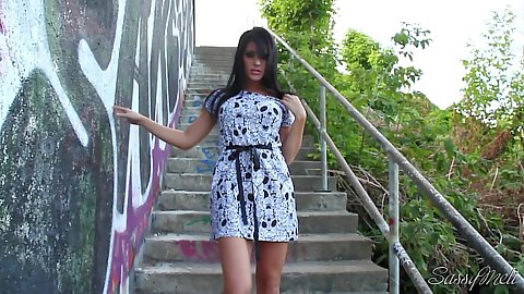 Sassy Meli finds a secluded staircase in public to feel up her pussy outdoors