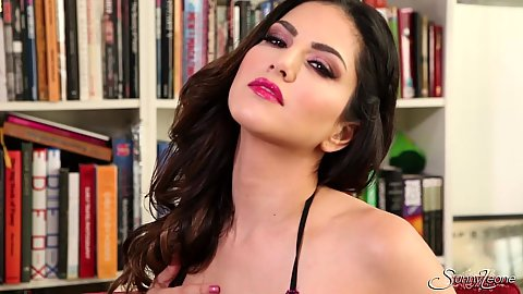 Lusty lingerie babe Sunny Leone getting naughty in library solo