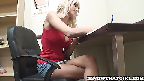 Sexy Jennifer at the library desk