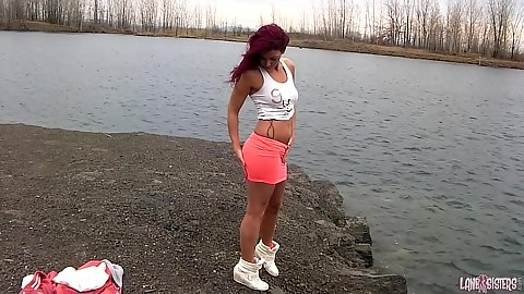 Redhead girl Roxy Lane goes by the lake to get naked solo