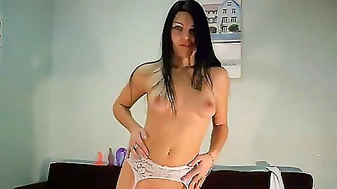 Milf is doing an erotic dance at home