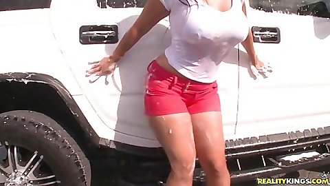 Soaping round ass babe getting a car wash