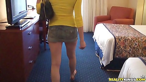 Cute teen jumps on the bed and shows up her skirt