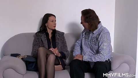 Fully clothed milf Valeria Jones has a chat on couch