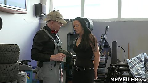 Car garage fully clothed Roxy Roxx sucks dick