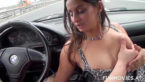 Grabbing tits as Lolita sucks my cock in pov driving a car