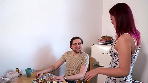 Redhead fully clothed Natalie Hot approaching a nerd in the kitchen to put his penis in mouth
