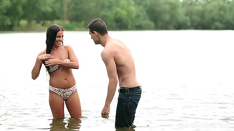 Eveline Dellai offers boy to join her for a sexy swim and kiss