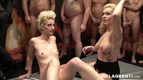 Curly Ann and Jil Thomson do gang bang with dozen men ready to cum over them
