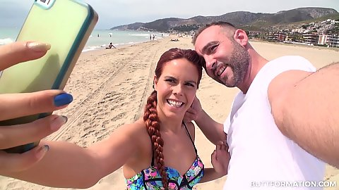 Gala Brown taking a selfie on the beach with random guy