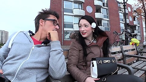 Picking up fully clothed Larissa White on a public bench on the streets of Rotterdam