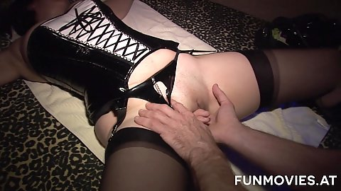 Fingering a corset wearing bitch in underground sex club