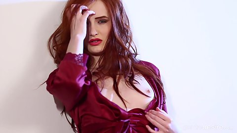 Redhead babe Denisa Heaven solo stripping