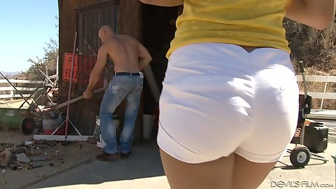 Tight little shorts girl Amethyst Banks approaching guy doing garden work