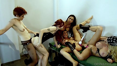 Lily Cade and Violet Monroe with Lily Lane fucking with strap ons in prison