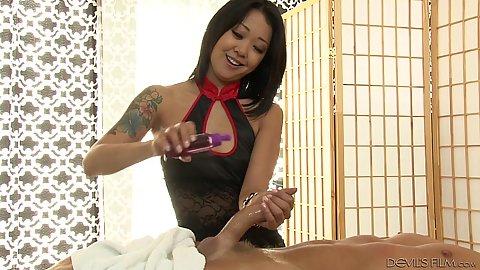 Saya Song applying some oil on cock to give handjob