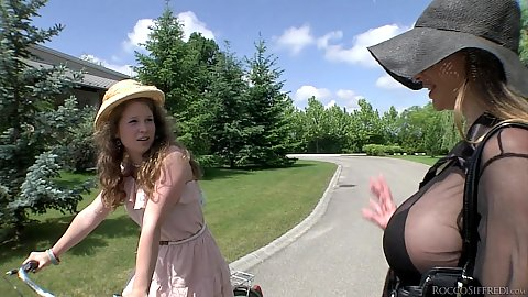 Cathy Heaven and Bunny Baby driving their bicycle outdoors