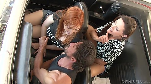 Redhead and brunette Lauren Phillips and Christina Carter sucking some penis in car