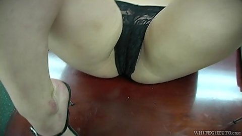 Posing her pussy and tits on the desk with Nikki Nievez