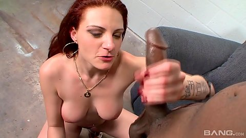 Redhead Nikki Nievez is on fire and sucking black penis