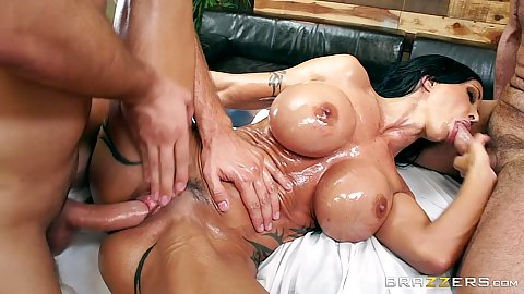 Very oiled and very slippery milf Jewels Jade fucked by two guys on massage table