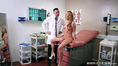 Angelic Carter Cruise sits naked and lets doctor do things her