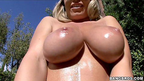 Sexy oily Jessica Moore flashing her anus outside