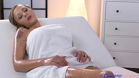 Lovely oiled body girl Katarina Muti wrapped in towel getting massage from man