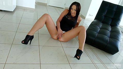 Deborah Diamond on the floor with spread legs digging her own cunt