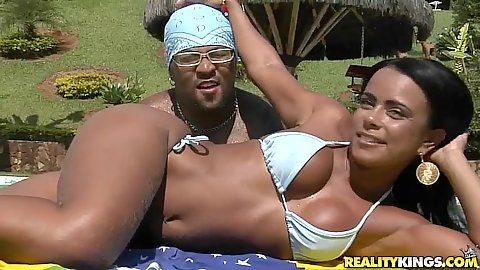 Sexy Latina babe Brennda in a tight bikini